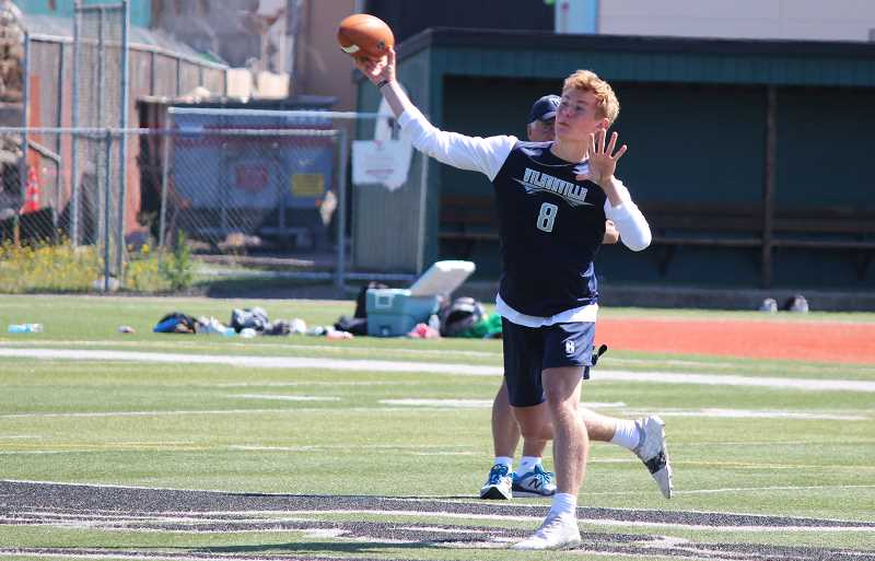 PMG PHOTO: DEREK WILEY - Wilsonville quarterback Jayce Knapp throws a pass Saturday in 7-on-7 work at Tigard High School.