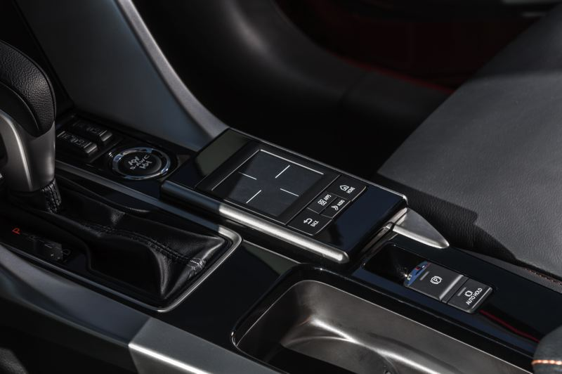 COURTESY MITSUBISHI - The infortainment system is controlled by an easy-to-use touchpad on the center console. The center differential of the Super All-Wheel Control can be locked by the button in front of it.