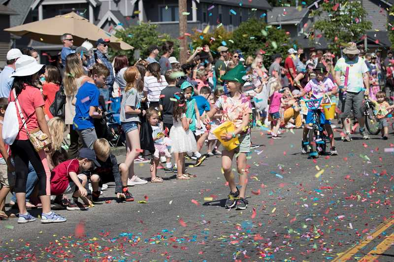 PMG FOTO: JAIME VALDEZ - Confetti lands on South Pine Street during the Robin Hood Festival Parade.