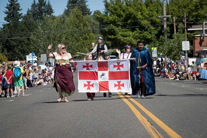 PMG FOTO: JAIME VALDEZ - People dressed in medieval clothing march down Southwest Pine Street during the Robin Hood Festival Parade.