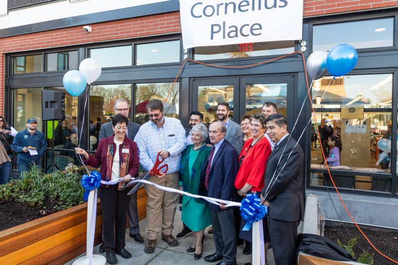 PMG PHOTO: CHRISTOPHER OERTELL - Cornelius Mayor Jef Dalin cuts the ribbon during the grand opening celebration at Cornelius Place in Cornelius on March 30.