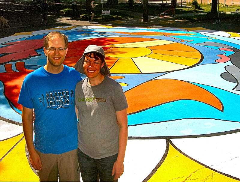 RITA A. LEONARD - Justin and Virinia Horland coordinated the new street painting Springwater Crossing in the intersection of S.E. 16th and Sherrett Street, near Sellwood Middle School.