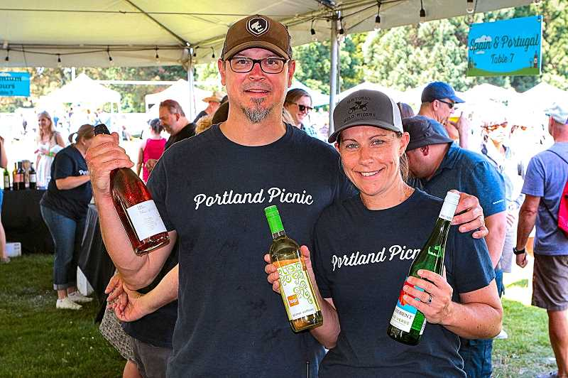 DAVID F. ASHTON - Portland Picnic hosts Travis and Emily Motter invites guests to sample fine wines, brought in from all over the world - in the Portland Bottle Shop Tasting Tent, a fundraiser for the nonprofit Ride Connection.