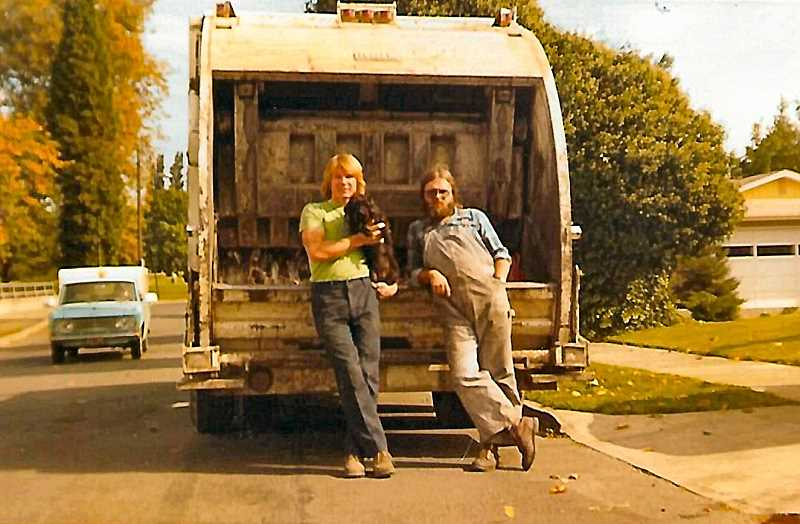 COURTESY OF THE HEIBERG FAMILY - Heres a 1970s photo of two groovy guys - Bruce Heiberg on the left and Bill Cuddy on the right, just chillin by the Heiberg Garbage truck, after a hard day hauling trash cans.