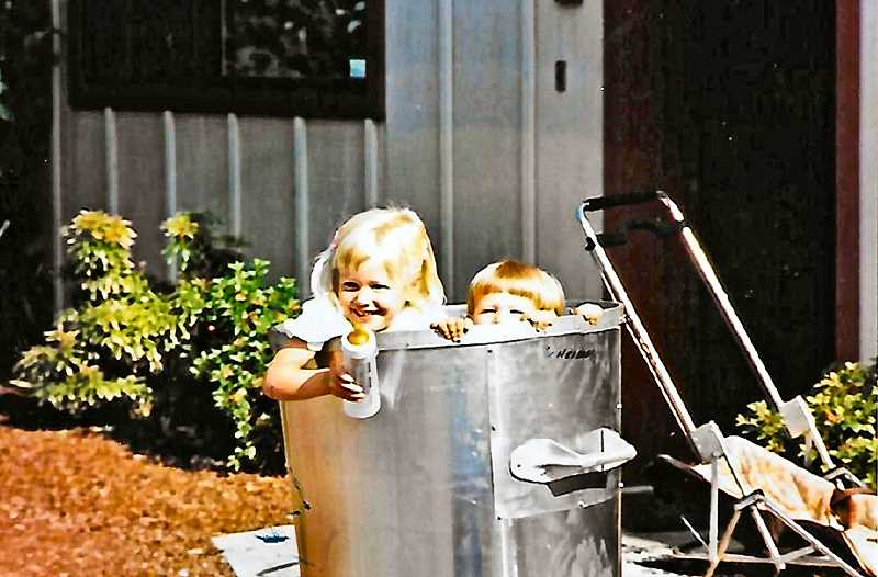 COURTESY OF THE HEIBERG FAMILY - No, thats not a new type of child carrier - thats Jessi and Jimmy Heiberg in one of the Carry Cans that the Heiberg boys used for picking up trash from multiple homes along the route.