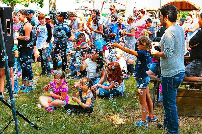 DAVID F. ASHTON - A sea of bubbles float into the air, in remembrance of The Dougy Center clients departed loved ones, as the climax of Michael Freres Kids Day at Oaks Amusement Park.