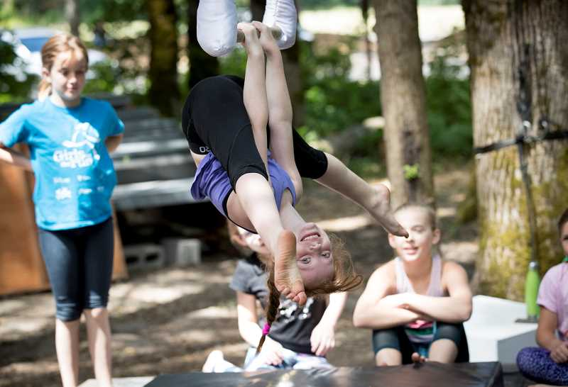 PMG PHOTO: JAIME VALDEZ - Local youth can practice fun tricks during an Aerial Dance Camp in West Linn.