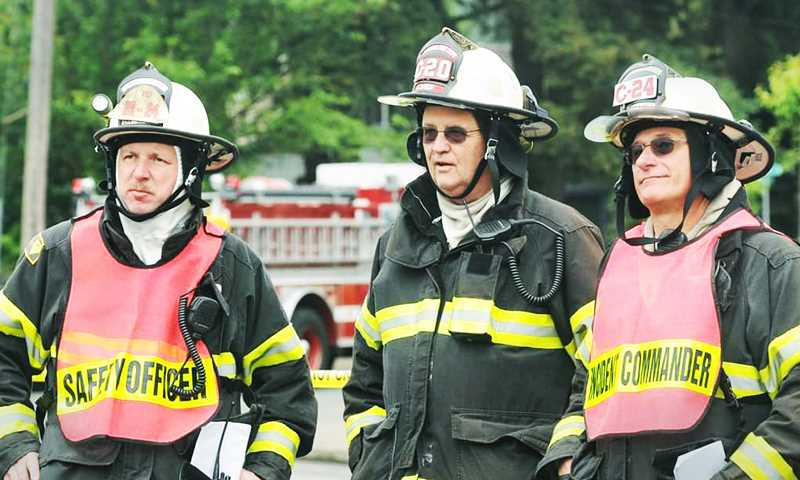 PHOTO COURTESY OF MISSY LOVE - Al Blodgett (center) served as a member of the Newberg Fire Department for many decades, and as chief for several years before his retirement.