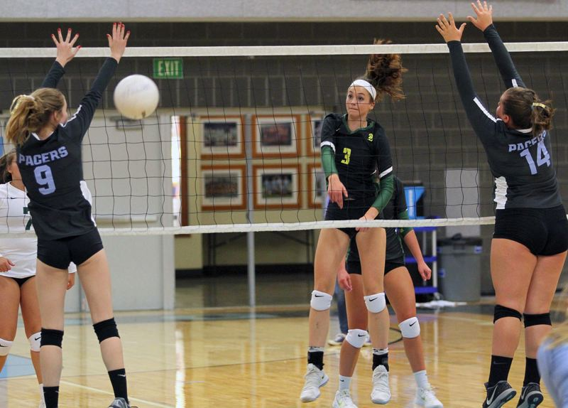 PMG PHOTO: MILES VANCE - West Linn sophomore Audra Wilmes (here making a kill during her team's sweep at Lakeridge High School in September) and the Lions finished third at state, and in the process, helped West Linn finish second in the OSAA Cup standings for Class 6A schools in 2018-19.