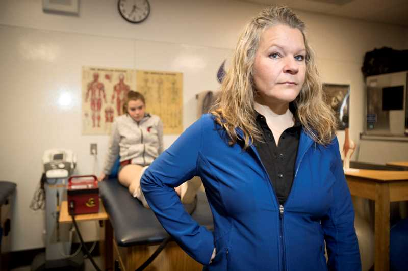 JAIME VALDEZ/ PAMPLIN MEDIA GROUP - Shelly Jones, the athletic trainer at Aloha High School in Oregon's Washington County, says on some days she's so busy that athletes needing her attention head right to practice rather than wait in line. Most Oregon high schools don't have a full-time trainer. Crook County is one of the fortunate schools that does.