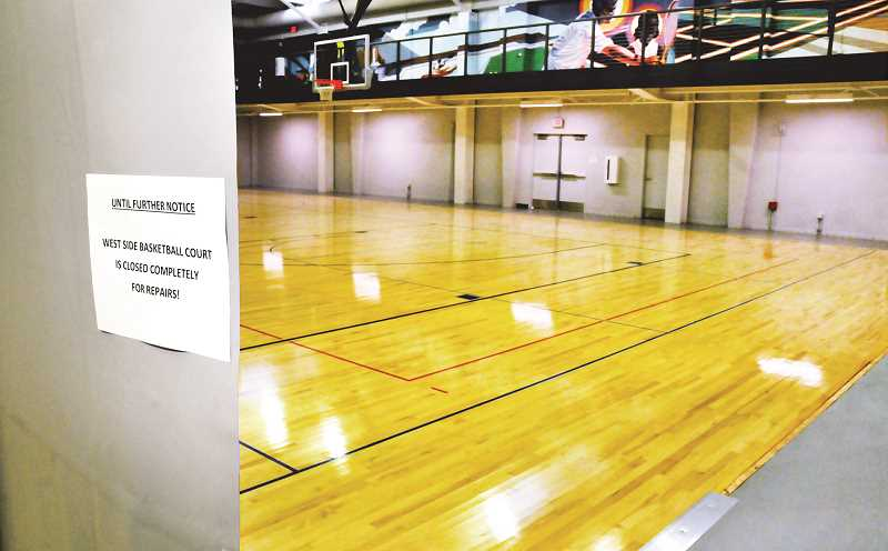GRAPHIC PHOTO: GARY ALLEN - A sign, some caution tape and a few spots of disrepair are what indicated to the public that half of the fitness center court was off limits until repairs could be made.