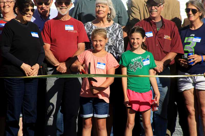 STEELE HAUGEN - Brooke Clarkson and Marley Simmelink cut the ribbon after the completion of the pavilion.