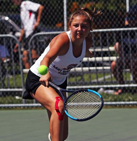 PMG PHOTO: DAN BROOD - Emily McDonald finished her tennis career at Sherwood by winning a Pacific Conference district singles championship.