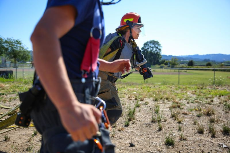OPB PHOTO: CHEYENNE THORPE - Trainees at the Fire-Up Bootcamp had the chance to practice pulling, deploying and loading hoses.