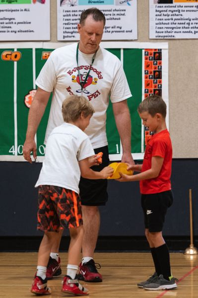 PMG PHOTO: CHRISTOPHER OERTELL - Neill Twigg, one of the founding partners of Everybody Loves PE, facilitates a unique game of tag at their camp last Thursday, July 18, at Orenco Elementary in Hillsboro.