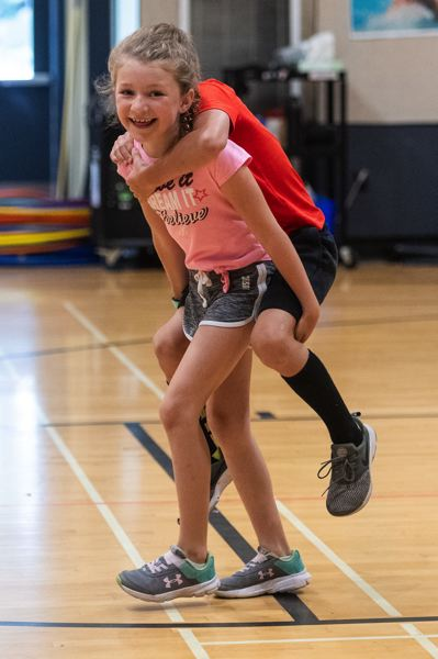 PMG PHOTO: CHRISTOPHER OERTELL - Two campers enjoy their time during a game at Everybody Loves PE class July 18 at Orenco Elementary in Hillsboro.