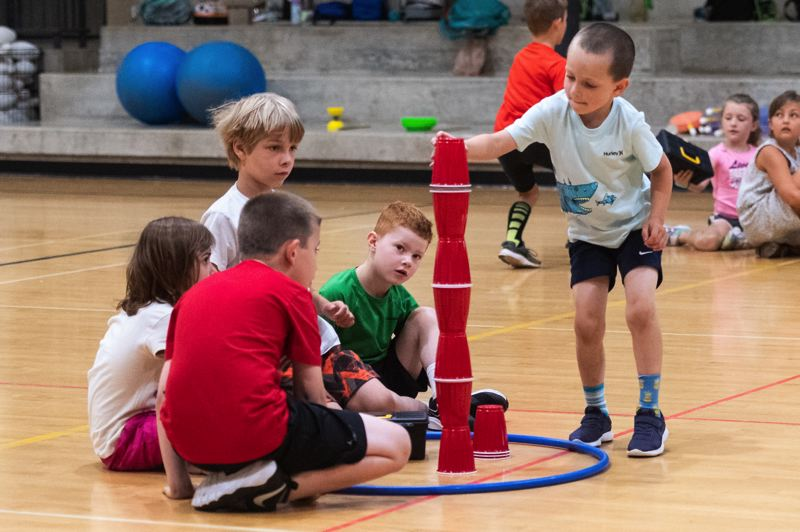 PMG PHOTO: CHRISTOPHER OERTELL - A group of young campers participate in a relay game as part of Everybody Loves PE last Thursday, July 18, at Orenco Elementary in Hillsboro.