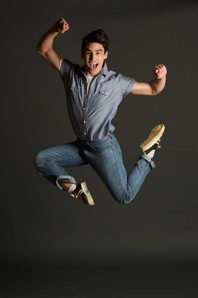 "COURTESY PHOTO: CRAIG MITCHELLDYER - Eric Asakawa stars as Ren in ""Footloose"" at Broadway Rose Theatre Company in Tigard."