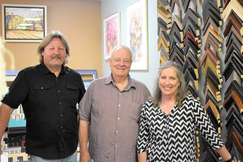 PMG PHOTO: EMILY LINDSTRAND - Dave Anderson, Allen Cameron and Ellen Anderson stand next to some of the Artsmiths options for framing.