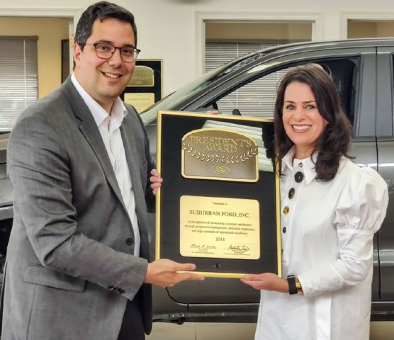COURTESY PHOTO - Ford Motor Company Regional Manager John Mikhail presents the President's Award to Suburban Ford General Manager Erinn Sowle.