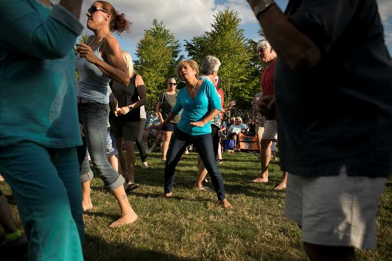 PMG PHOTO: JAIME VALDEZ - Lucia Reynolds of Tigard dances to the music by Johnny Limbo and the Lugnuts during Wilsonvilles Rotary Summer Concert at Town Center Park. Photo by Jaime Valdez