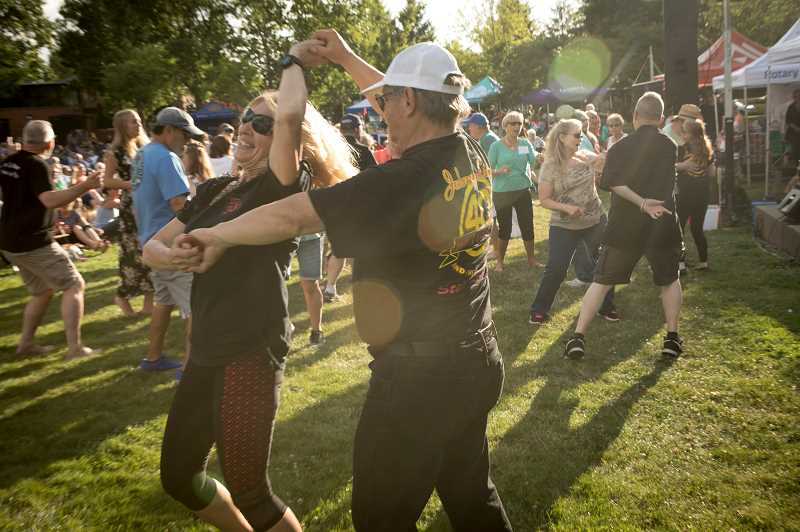 PMG PHOTO: JAIME VALDEZ - Debra and Chuck Andrus of Vancouver dance to the music by Johnny Limbo and the Lugnuts during Wilsonvilles Rotary Summer Concert at Town Center Park. The Andruses have following the band for over twenty years.