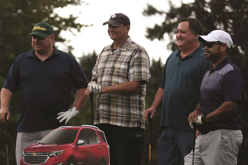 PMG PHOTO: PHIL HAWKINS - Fourteen teams particpated in Love INC's third annual golf tournament fundraiser at OGA Golf Course in Woodburn on Thursday.