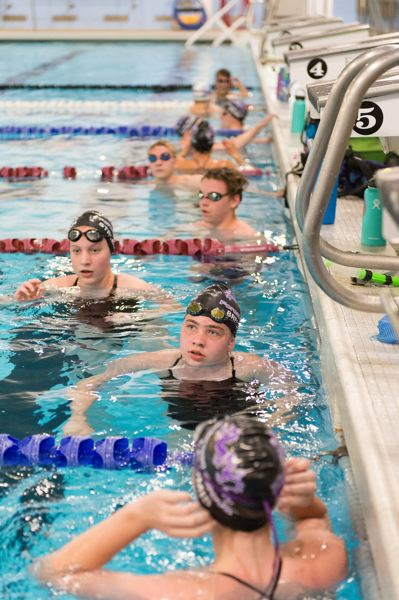 PMG FILE PHOTO: CHRISTOPHER OERTELL - Forest Grove Swim Club members await instructions during practice at the Forest Grove City Aquatic Center last year.