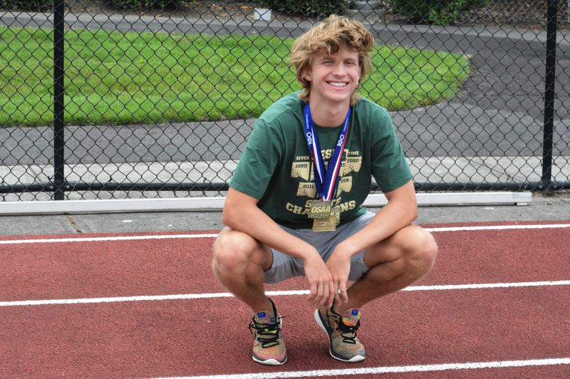 TIMES PHOTO: MATT SINGLEDECKER - Jesuit senior Will Sheaffer won Class 6A state championships in basketball and track and field for the Crusaders.