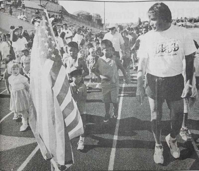 MADRAS PIONEER FILE PHOTO - Olympic gold medalist Billy Mills attends youth track meet at Madras High School in July 1994.