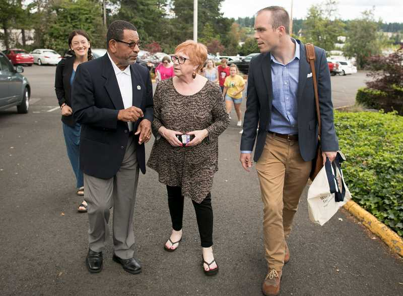 PAMPLIN MEDIA GROUP: JAIME VALDEZ - Flanked by King City Mayor Ken Gibson ,left, and Oregon Rep. Margaret Doherty, Ben Bowman, the newest member of the Tigard-Tualatin School Board, walks into the Tigard-Tualatin School District building July 15 shortly before being sworn in as its newest member.