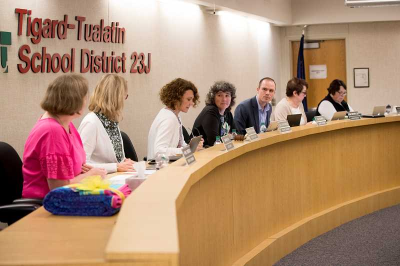 PAMPLIN MEDIA GROUP: JAIME VALDEZ - Ben Bowman, center, takes the dais as the newest member of the Tigard-Tualatin School Board, shortly after being sworn in on July 15.