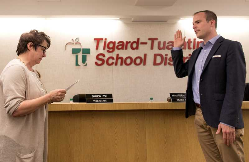 PAMPLIN MEDIA GROUP: JAIME VALDEZ - Tigard-Tualatin School District Superintendent Sue Rieke-Smith swears in Ben Bowman, the youngest known school board member in district memory, on July 15.