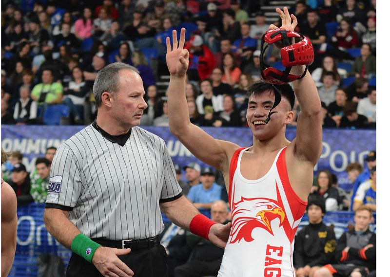 PMG PHOTO: DAVID BALL - Centennial senior Phillip Kue acknowledges the Eagles cheering section after taking a 4-1 win in the 132-pound title bout to cap his high school career in February.