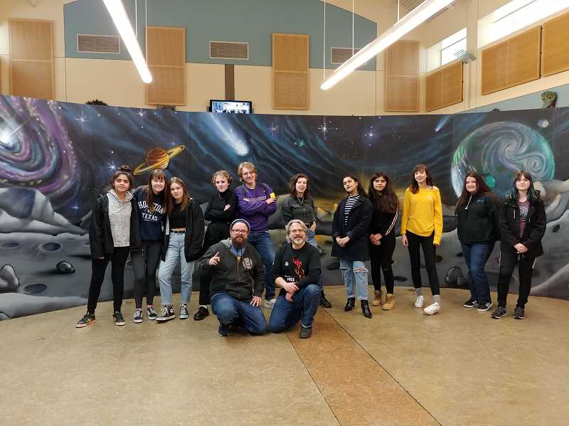 COURTESY PHOTO - WHS art students, along with art teacher Christopher Shotola-Hardt and muralist and WHS graduate Derek Leitch, crafted a space mural.