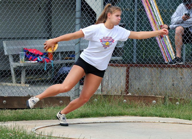 PMG PHOTO: JIM BESEDA - West Linn's Makayla Long, an incoming junior, works on her discus skills at the Super Thrower Track Club in Oregon City recenly.