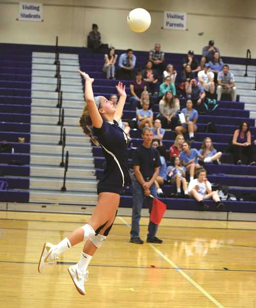 PMG PHOTO: FILE PHOTO - Ruby Kayser serves the volleyball during her junior season at Canby High School.
