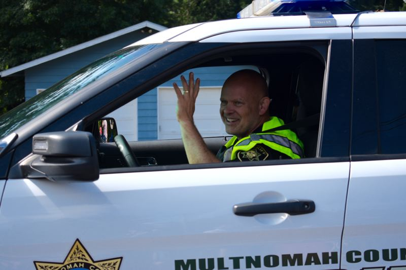 PMG PHOTO: MATT DEBOW - Deputies, nurses and many other Multnomah County employees have been dealing with erroneous paychecks for months. Pictured, Sheriff's deputy Joe Rocky Graziano drives his car through the July 4th parade in Corbett.