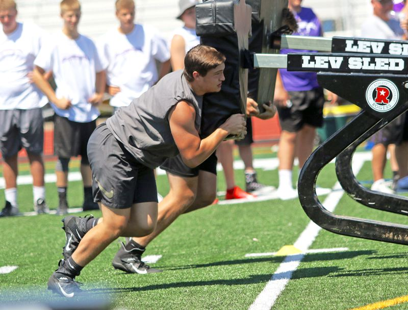 PMG PHOTO: DAN BROOD - Cody Van Meter, a Tualatin senior-to-be, helped the Wolves take second place in the blocking sled relay during the Metro Area Lineman Challenge.