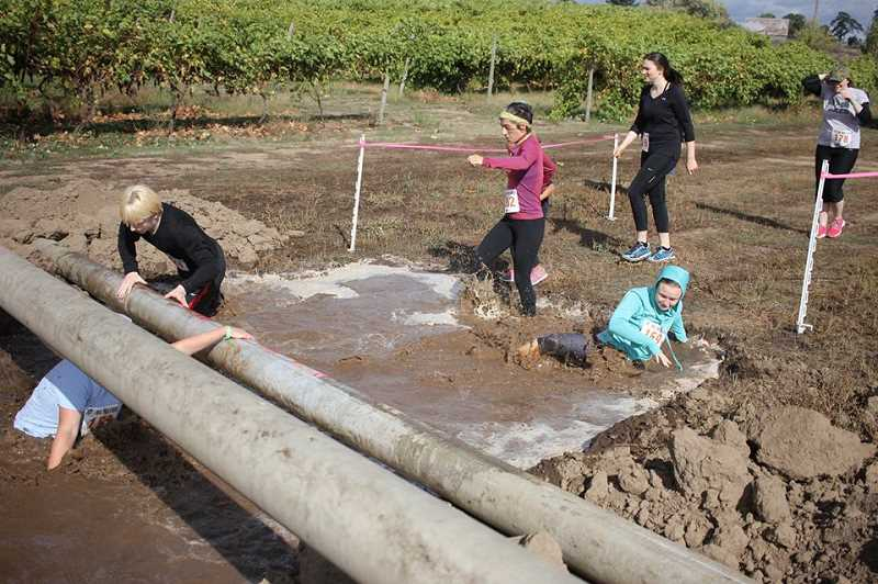COURTESY OF WOODBURN ROTARY - Mud Run participants can expect another challenging obstacle course.