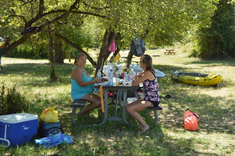 PMG PHOTO: NICOLE THILL-PACHECO - Heather Bell and Tauni Osterman, both St. Helens residents, enjoy a campsite on Sand Island on Monday, July 22. Camping on the island offers great views, solitude and a variety of activities for a quick getaway, they explained.