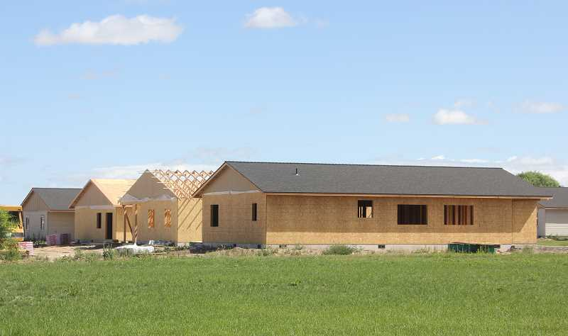 DESIREE BERGSTROM/MADRAS PIONEER - Several homes are under construction in two subdivisions in Metolius — Roy Heart Estates and Havilah Estates. The projects have combined for 26 home permits since the beginning of the year.