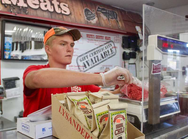 PMG PHOTO: CHRISTOPHER KEIZUR - Crosby Janzen, a Corbett resident who works at Whites Country Meats.