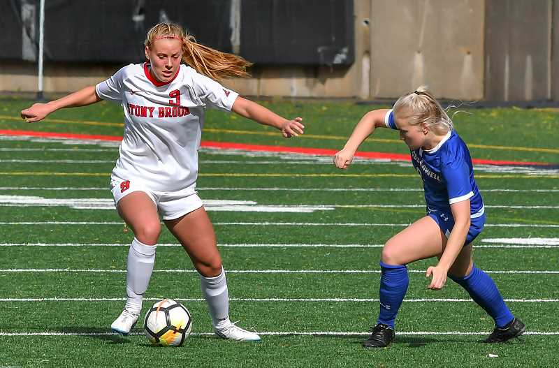 COURTESY PHOTO: STONY BROOK UNIVERSITY - Chase Rome drives past a University of Massachusetts Lowell defender during her sophomore soccer season at Stony Brook University.
