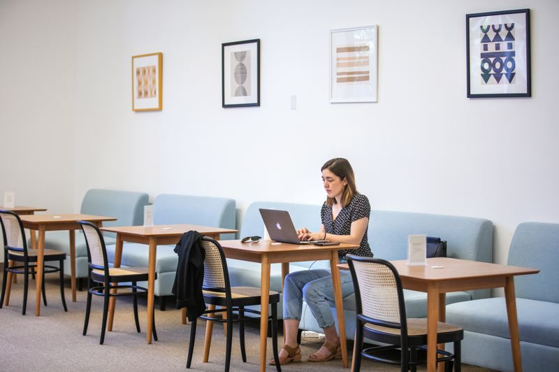 PMG PHOTO: JONATHAN HOUSE - Leah Lavelle works in an open cafe-like space at The Riveter.