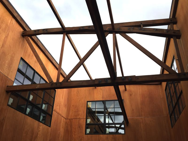 PMG PHOTO: BRIAN LIBBY - Pioneer Lavada Jones, set to open later this summer, features old roof trusses that extend over the courtyard, passing from inside to outside and back again,