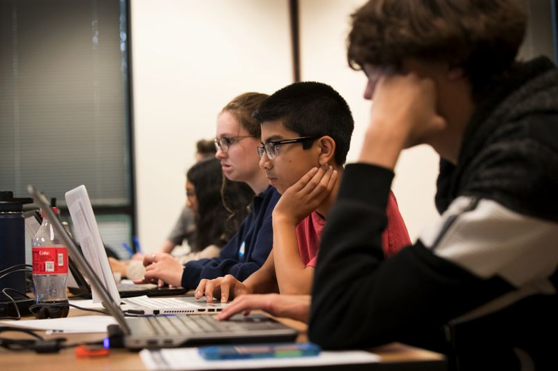 PAMPLIN MEDIA GROUP: JAIME VALDEZ - Lauren Hurley 16, left, Sean Khanna,15, and Matthias Gutzmann,17, working on coding during a NW Cyber Camp 2019 at Mentor Graphics in Wilsonville.