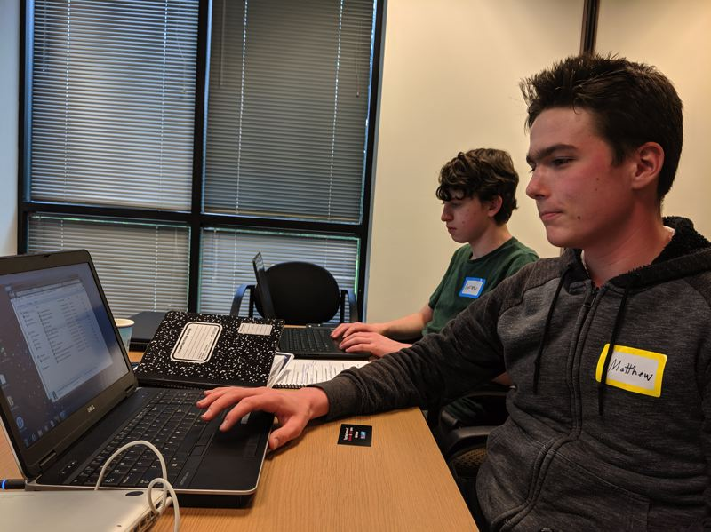 PAMPLIN MEDIA GROUP: JOSEPH GALLIVAN - Students at NW Cyber Camp at Mentor Graphics in Wilsonville, where they learned the basics of firewalls, passworrd management and threat assessment. With 3,000 or 9,000 well-paying cyber security jobs statewide unfilled, demand is intense. Matthew Cummings  demonstrated how to delve into Windows 10 on a Windows 7 machine.