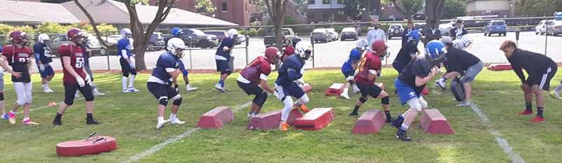 SUBMITED PHOTO - Players work on agility drills during Western Oregon team camp.