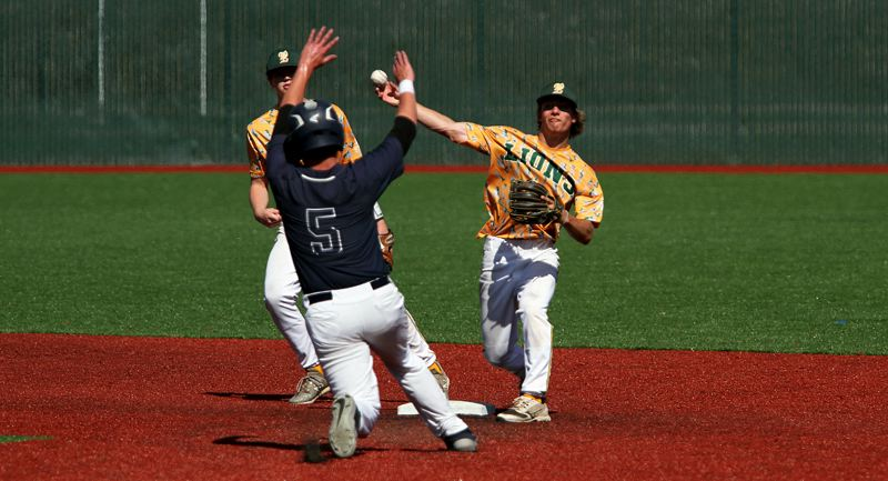 PMG PHOTO: MILES VANCE - West Linn second baseman Caden Parker turns a double play as Lake Oswego's Brad Holmes slides into second base in LO's 10-1 win in the OIBA National Tournament on Friday, July 26, at Tualatin High School.